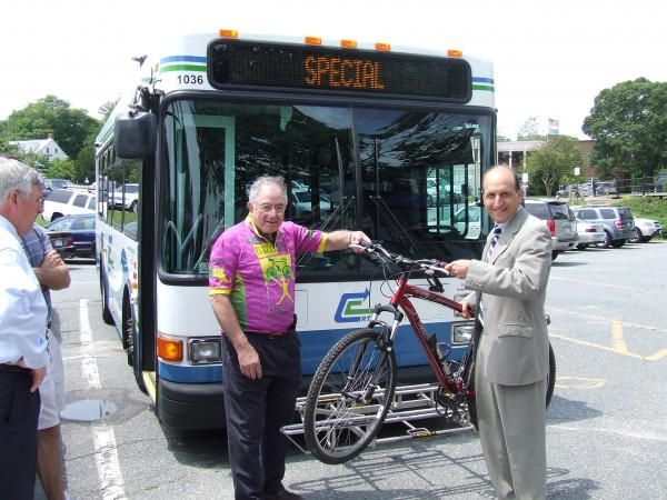 Dr. Ed Gross poses with then-Senator Dan Wolf to highlight bicycle accessibility features of Cape Cod RTA buses.
